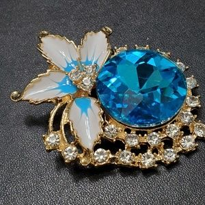 Gold tone blue and white flower brooch